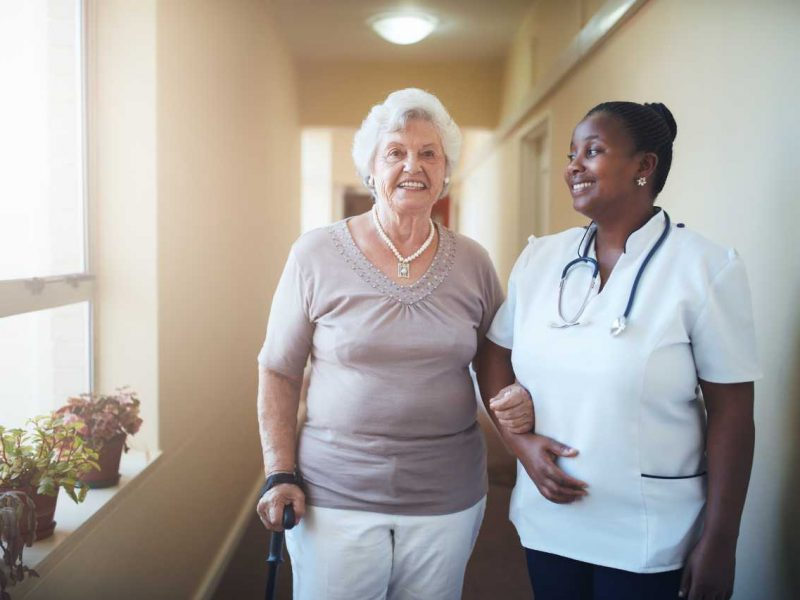 happy-doctor-and-patient-together-at-nursing-home-PXYBPA2 (1)