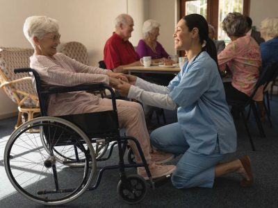 happy-doctor-and-patient-together-at-nursing-home-PXYBPA2 (2) (1)